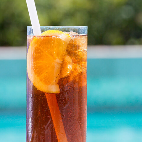 iced tea glass in front of a pool