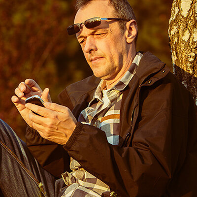 Man sitting outside with smartphone