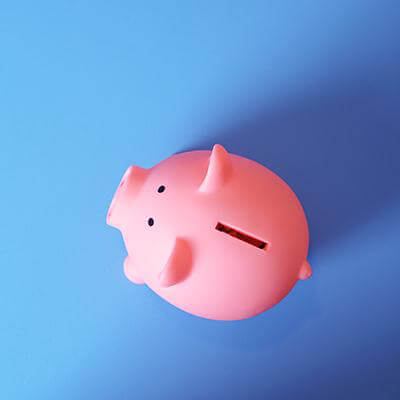 A Pink piggy bank on a table