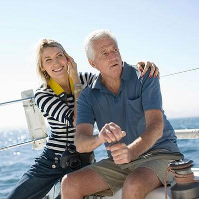 A man and his wife on a boat sailing