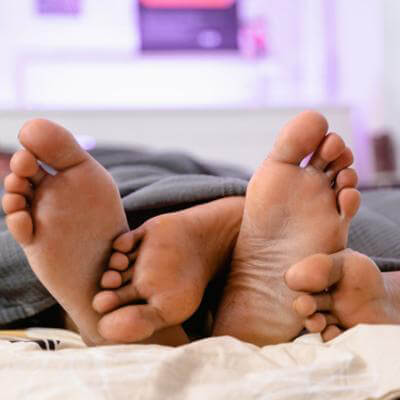 couple laying in a bed