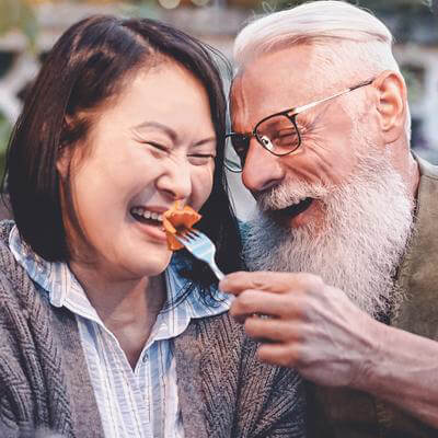 A man and his wife eating