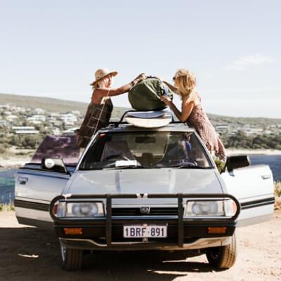 Women packing up a car
