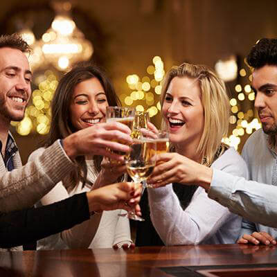 5 people cheering after a toast