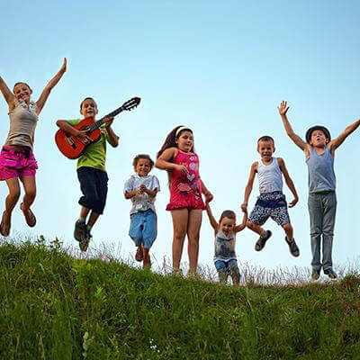 Group of young kids jumping in the air