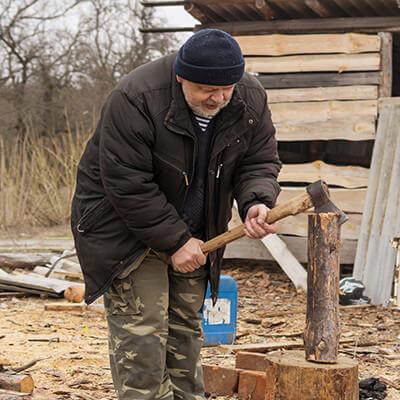 Man chopping wood outdoor