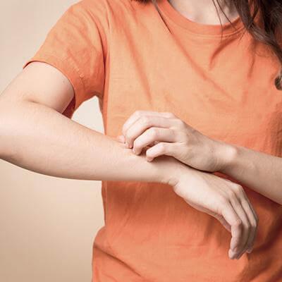 Man scratching his arm
